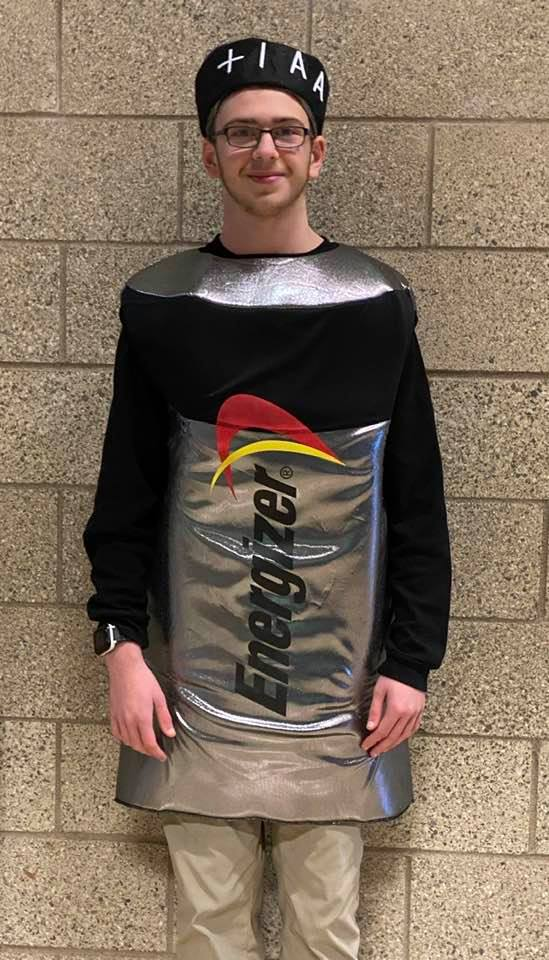 Man dressed in a battery costume.