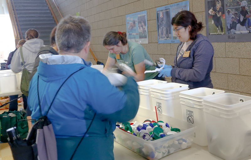 Volunteers sort rigid plastics